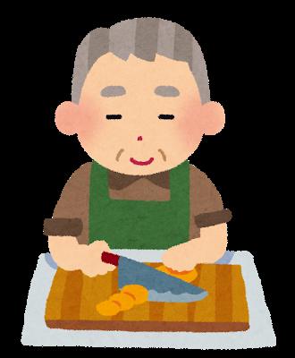 調理している老人