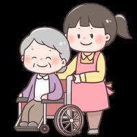 車椅子を押している介護士